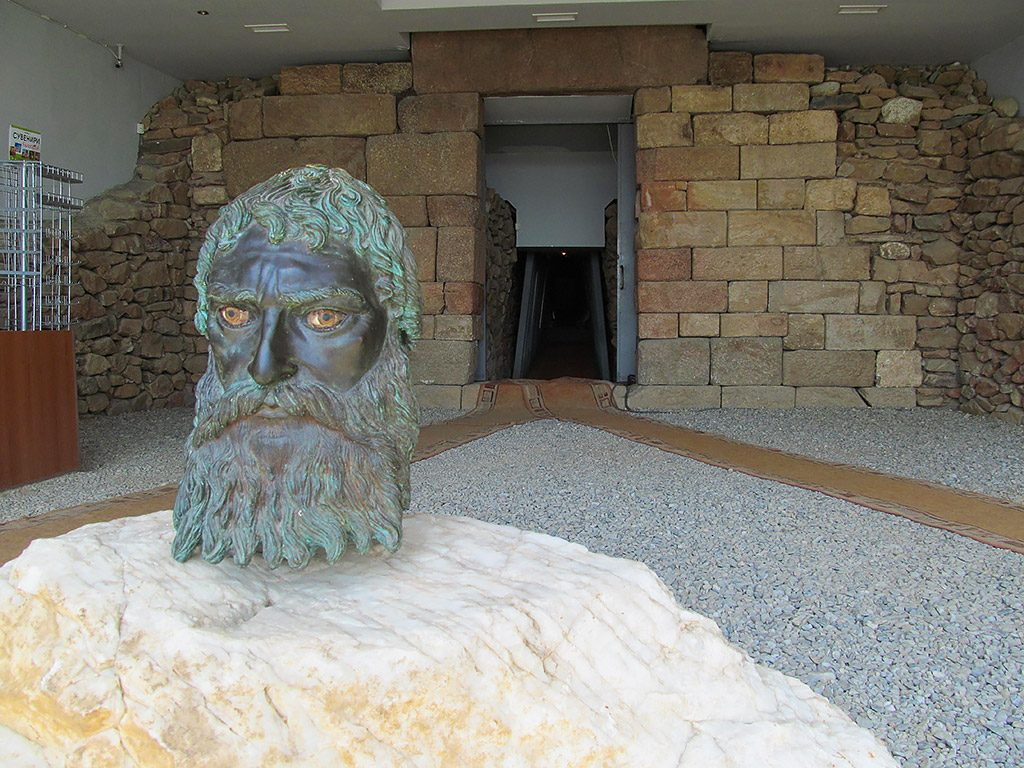 The Thracian tomb-temple Goliama Kosmatka - bronze head of Seuth III & main entrance